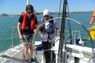 blind children sailing the yacht on our activity break for blind and visually impaired