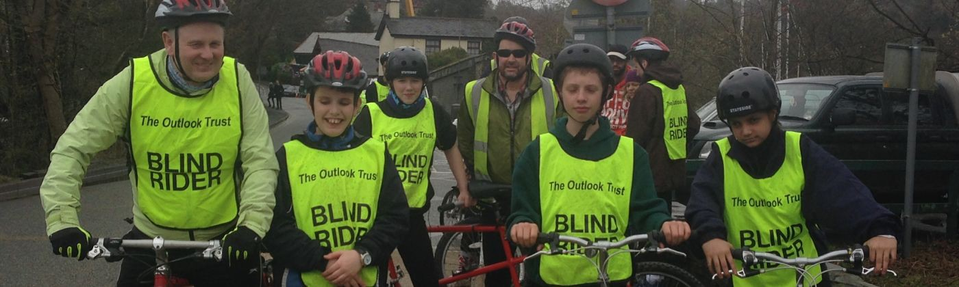 Blind riders enjoy the cycling activity.